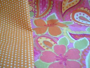 pink and orange floral with orange polka dot lining